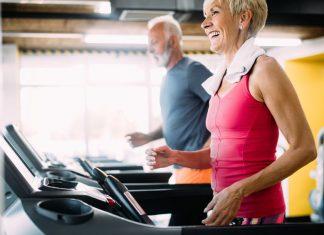 Senior man and woman exercising on treadmills